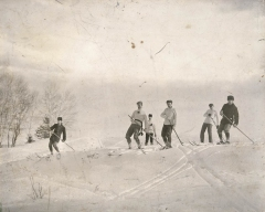 Group cross-country skiing in Canada, using long poles to steer This group was photographed in 1895. (Library and Archives Canada, C-043152)