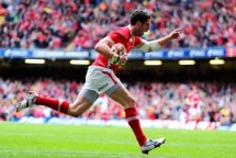 Alex Cuthbert's first-half try set Wales on the road to a revenge win over France which secured them the 2012 Grand Slam
