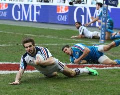 Hugo Bonneval plunges over the line for France's third try in their 30-10 win over Italy at the Stade de France